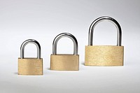 Three different sized padlocks in a row