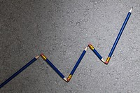 Pencils arranged to depict an ascending line graph