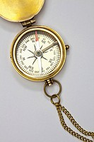 A brass pocket compass