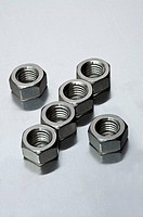 Metal nuts arranged in a pattern