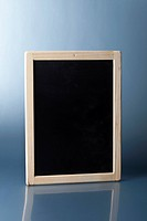 A small blank chalkboard standing upright