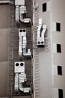 Anthropomorphic air vents on side of building
