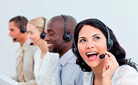 Laughing businesswoman and her team working in a call center