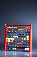 An abacus with multi colored wooden beads (thumbnail)