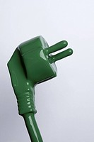 A plug and cable painted green
