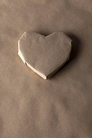 A heart shaped object wrapped in brown paper
