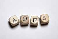 Lettered cubes spelling ADHS, the German acronym for Attention Deficit Hyperactivity Disorder (thumbnail)