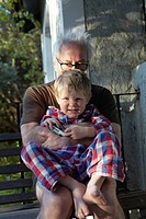 Older man hugging grandson outdoors