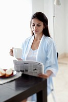 Woman reading the morning newspaper