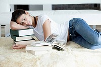 Woman sleeping on her books