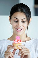 Woman pleased with flower_head cupcake