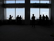 Silhouette tourists view Tokyo cityscape