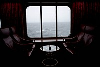 View of Pacific Ocean through the window of lounge area on a passenger ship