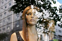 Mannequins looking at the street buildings
