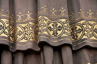 Golden detail of garment on clerical statue of Saint Ansgar