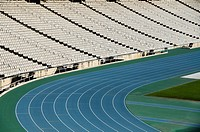 Running track curves and empty bleachers in sport stadium