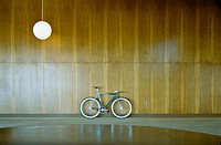 Bike parked against wood paneling