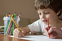 A boy and a friend drawing with colored pencils, viewpoint of boy