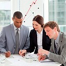Concentrated business people studying sales report