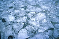Patterns of cracked ice on river