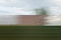 A building and sky in blurred abstract pattern seen from moving train (thumbnail)