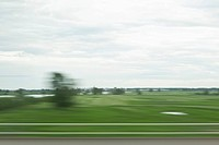A rural landscape in blurred motion viewed from a moving train (thumbnail)