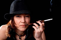 Woman with cigarette holder