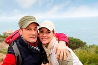 Portrait of happy couple on hiking day