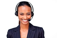 Beautiful ethnic businesswoman with a headset on smiling at the camera