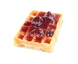 Tasty waffles with jam, isolated on white