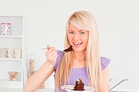 Beautiful caucasian woman eating cake
