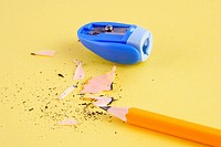 A pencil beside a sharpener
