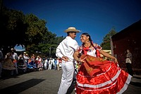 A young couple wearing traditional dresses dance during the Guelaguetza parade in Oaxaca, Mexico, July 21, 2012  Oaxaca commemorates the 'Guelaguetza,...