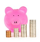 Piggy bank with coin stacks
