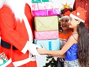 Girl taking Christmas presents