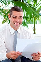Happy Businessman examining some reports