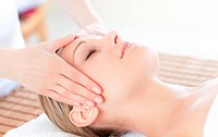 Close_up of a bright woman receiving a head massage