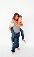 Young boy giving his girlfriend piggyback ride