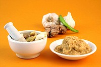 Garlic and ginger in a mortar with pestle and ginger,garlic paste with chilly