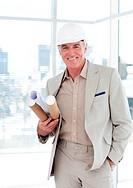Senior architect with a hardhat holding blueprints