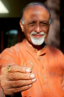 Old man holding a ring