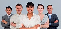 Smiling multi_ethnic business team with folded arms