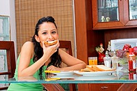 A woman having breakfast