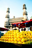 Distant view of Charminar from a fruit stall