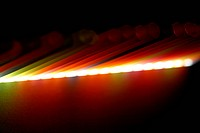 Colourful image of illuminated straws, close up