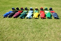 Cricket helmets and jerseys on the ground