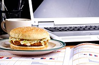 Partial view of a lap top with a burger
