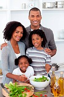 Ethnic family preparing salad together