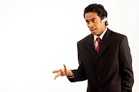 Young business man wearing hands_free device