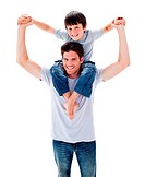 Positive father giving his son piggyback ride